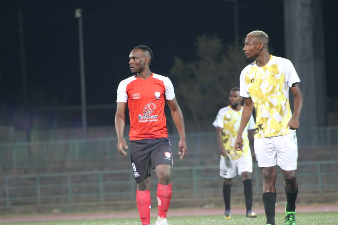 Patrick Kaunda(red) of Jwaneng Galaxy and Thato Seagatleng(yellow) of Notwane looking on.The game ended with a 1 nil win for Galaxy