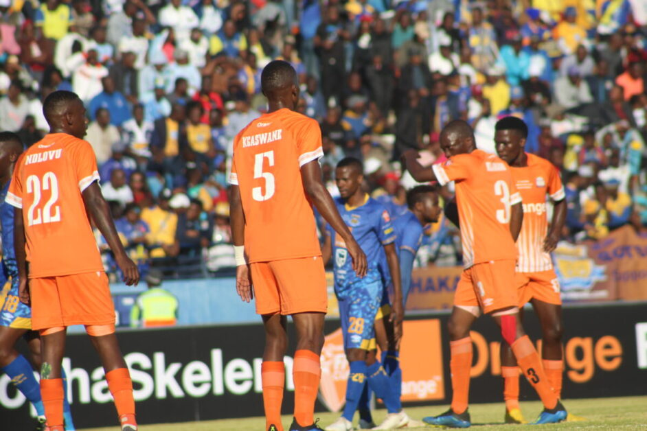 Botswana football, Orapa United and Township Rollers players in a field