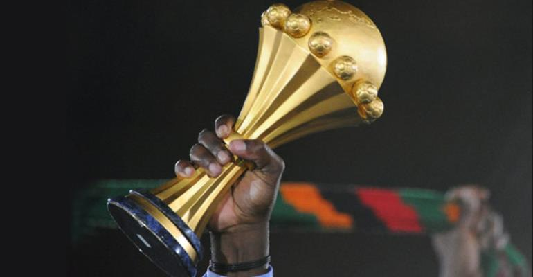 a hand holding an afcon title
